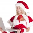 Santas helper laptop smiling — Stock Photo #12093852