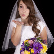 Bride blowing kiss — Stock Photo