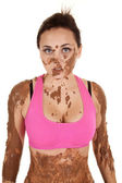 Woman pink sports top mud stare — Stock Photo