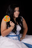 Teen girl colorful sucker — Stock Photo