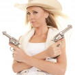 Cowgirl vest two guns crossed — Stock Photo #13590903