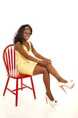 Red chair yellow dress — Stock Photo
