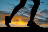 Woman legs run side silhouette — Stock Photo