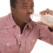 Royalty-Free Stock Photo: Man red shirt suck water bottle