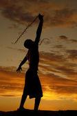 Silhouette man swing chain — Stock Photo