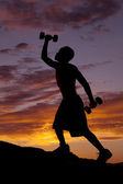 Silhouette man two weights — Stock Photo