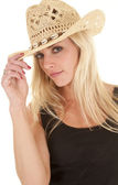 Cowgirl looking hold hat — Stock Photo
