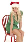 Woman green dress santa hat serious — Stock Photo