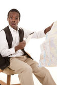 Tablet and map shocked — Stock Photo