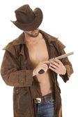 Looking at pistol hat brown — Stock Photo