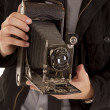 Close up camera in hands - Stock Photo