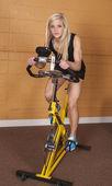 Woman gym bike looking — Stock Photo