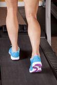 Woman legs treadmill back — Stock Photo