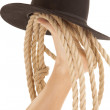 Royalty-Free Stock Photo: Foot cowboy hat and rope