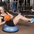 Woman fitness ball twist - Stock Photo