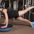 Woman fitness gym leg up — ストック写真