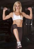 Woman white sports bra lifting — Stock Photo