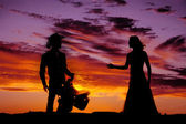 Couple western in sunset — Stock Photo