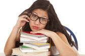 Asian woman on books glasses — Stock Photo