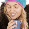 Woman hat coat mug eyes closed — Stock Photo #20239455