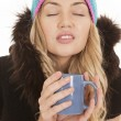Woman hat coat mug head back — Stock Photo #20239549