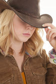 Blond cowgirl hat touch — Stock Photo
