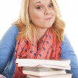 Girl with books smirk — Stock Photo