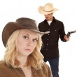 Cowboy holding two guns — Stock Photo #21152491