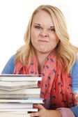 Girl books smirking — Stock Photo
