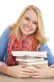 Girl hold books smiling — 图库照片