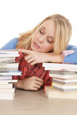 Girl lay on books look side — 图库照片