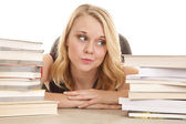 Woman between book stacks smirk — Stock Photo