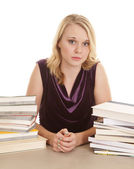 Woman between two books stacks serious — Stock Photo