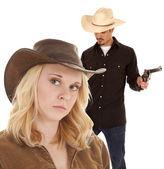 Cowboy holding two guns — Stock Photo
