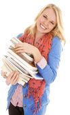 Kobieta uśmiech stos książek — Zdjęcie stockowe