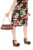 Flower dress purse legs — Stock Photo