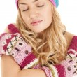 Woman hat mittens eyes closed serious — Stock Photo