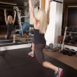 Stock Photo: Lunge back gym