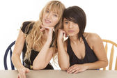 Woman dressy heads together — Stock Photo