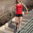 Womfitness red run down stairs — Stock Photo #22523949