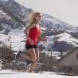 Woman fitness red run in snow — Foto de Stock