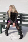 Woman bench outside snow look side — Stock Photo