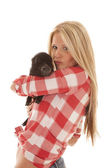 Woman red plaid pig hold — Stock Photo