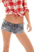 Woman red plaid shirt shorts body — Stock Photo