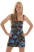 Woman hands hips flower dress — Stock Photo