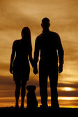 Silhouette of couple with a dog — Stock Photo