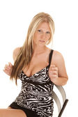 Woman zebra dress play straps — Stock Photo