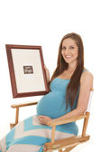 Pregnant hold ultra sound smile sit — Stock Photo
