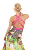Woman colorful dress back hand on neck — Stock Photo