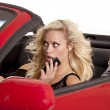Blond woman phone car scared — Stock Photo #29122465